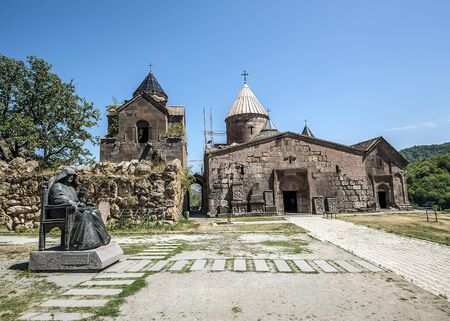 Armenia. The monastery complex Goshavank. Exterior with a monument to the founder of the monastery Mkhitar Gosh.