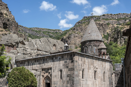 Armenia, the monastery of Gegardavank. The main church of the complex - Katogike, surrounded by khachkars, gavit (porch) of the church.