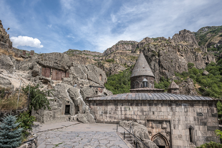 Armenia, the monastic complex Geghard. Entrances to the rock churches and the tomb of Proshyan are surrounded by ancient khachkars. 版權商用圖片 - 89944539