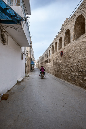 Tunisia, Sousse. The streets of the old city (Medina). Teenagers on a scooter.
