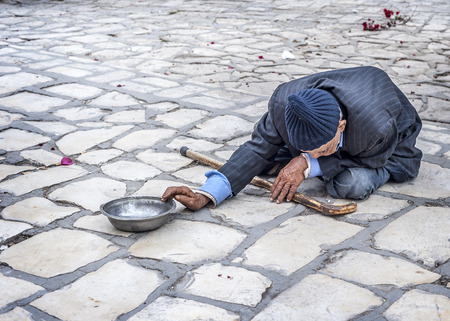 Tunisia, Sousse. Beggar on the square of the old city (Medina) at the walls of the Great Mosque. Editorial