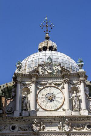 Italy, Venice. Patio of the Doges Palace. The main palace clock.