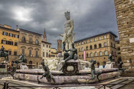 Italy. Piazza della Signoria - the square in front of the Palazzo Vecchio in Florence. The famous Neptune Fountain by Bartolomeo Ammanati. Thunderstorm May Day.