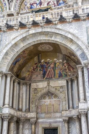 Italy. The Cathedral of the Sacred Mark - the cathedral of Venice. Fragments of the decoration of the main facade. Stock Photo