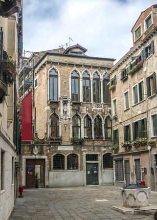 Italy, Venice. A small cozy and very authentic neighborhood - Campiello dei Squelini. Well in a small Square.