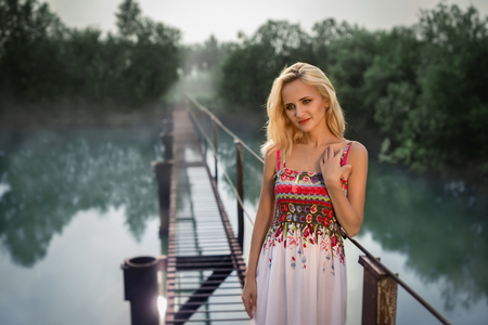 20 24 years: Beautiful girl at a pond in sundress