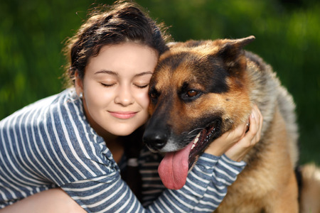 sheep dog: Portrait of a girl hugging shepherd dog with love