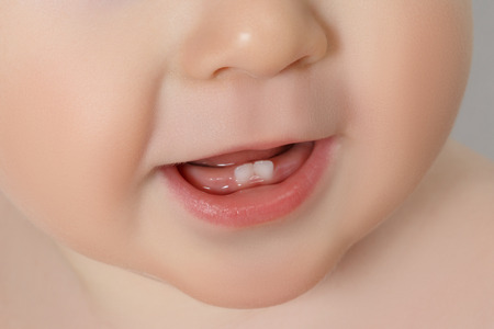 close-up Baby mouth with two rises teeth