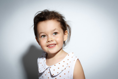 3 year old: Close-up Portrait of 3 year old little girl with dress, Smiling on bright white background Stock Photo