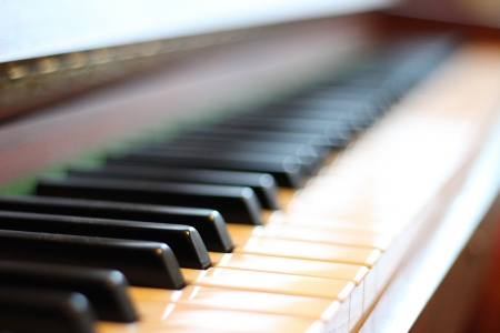 orchestrate: Close-up of black and white keys on a piano
