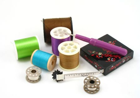 ripper: sewing supplies, thread, seam ripper, measuring tape and bobbins Stock Photo