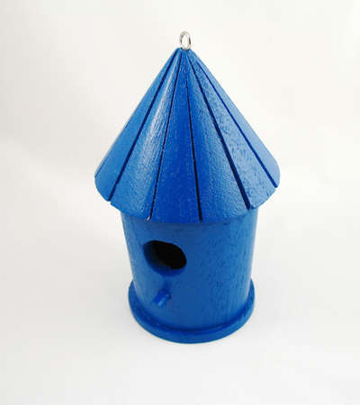 small blue bird house with sloped roof and perch