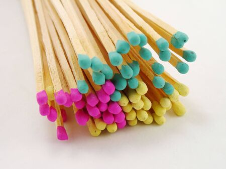 matchsticks with pink, green and yellow tips