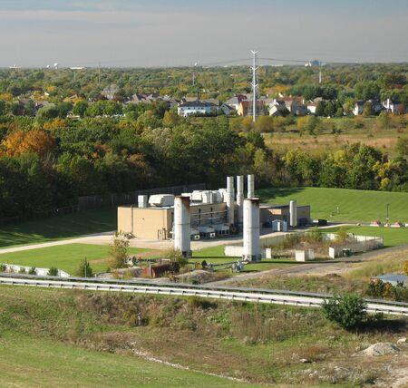smokestacks: incenerator plant with smokestacks during fall season