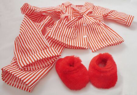 red striped pajama top and bottom with red furry slippers