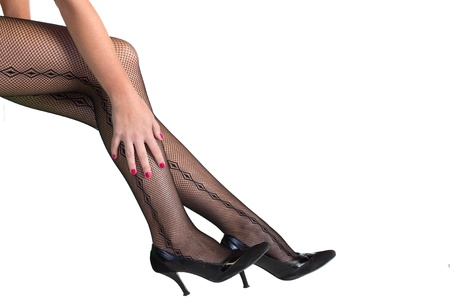 Young female legs in stockings and high heels photo