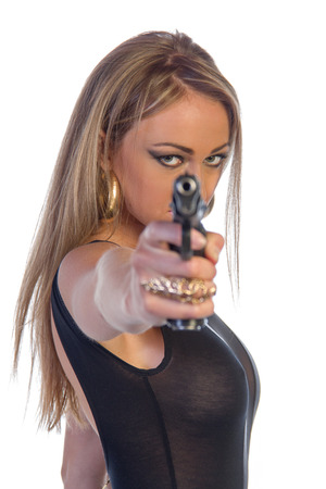 Extremely beautiful young woman with long blonde hair dressed in black leather pants holding a gun isolated on white photo