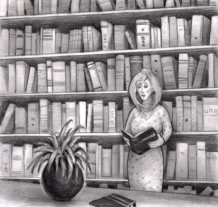 A woman reads a book in the library while standing up. Behind her are many more books on book shelves.
