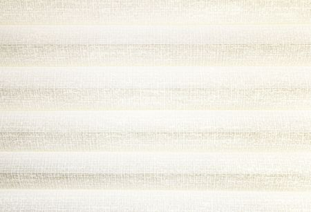 Parallel, light tan, off-white, honeycomb window shade rows cloth like texture background. Reklamní fotografie