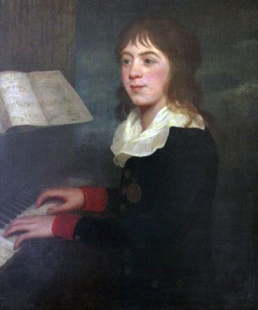 William Crotch, famous musician, composer, organist and artist. First Principal of the Royal Academy of Music, London, England is shown playing the piano when he was about 12 years old in this oil painting. He is wearing a black coat with red cuffs, gold  Stok Fotoğraf