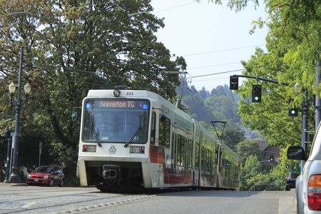 Portland, Oregon, August 5, 2010 - Street with a light rail train passing by.