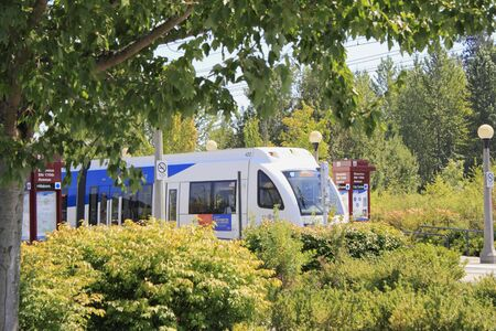 Beaverton, Oregon, August 3, 2010 - Public light rail Max train is seen through beautiful summer landscape.  Stock Photo - 7603314