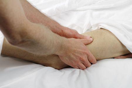 Close up of male massage therapist massaging thigh leg muscle of a guy. Stock Photo - 8169355