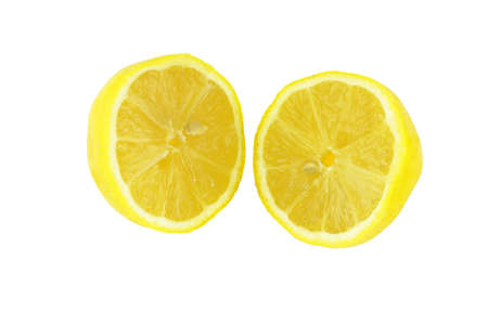 two and a half: Two fresh, bright yellow citrus fruit pieces on white. Stock Photo