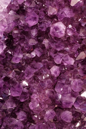 geode: Background of amethyst quartz crystal precious stones in a natural formation.