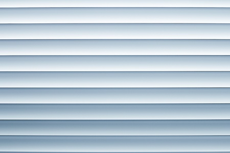 aluminium: Interior window blue mini blinds background keep the interior private and cool.