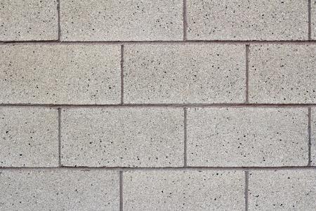 公立学校の建物の灰色のコンクリート ブロック セメント壁のクローズ アップ。