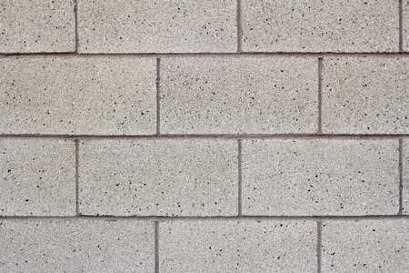 concrete blocks: Close-up of a gray cinder block cement wall of a public school building.