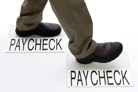 stepping: Person stepping from one paycheck to another paycheck.
