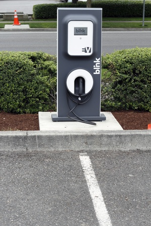 plugin: BEAVERTON, OREGON - JUNE 30: Blink electric vehicle charging station across from the city library on June 30, 2011 in Beaverton, Oregon. Some energy is supplied by photovoltaic (solar energy) panels.
