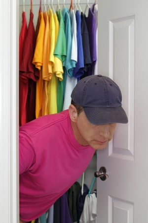 closet door: Older gay man coming out of the closet.