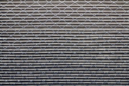 Closeup background of a dirty gray home furnace air filter that was white when it was new. Standard-Bild