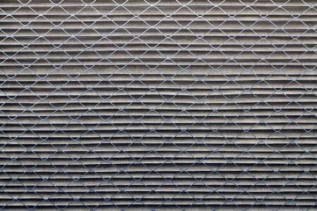 filtraci�n: Primer plano de un filtro de aire sucio gris de su casa horno que era blanco cuando era nuevo.