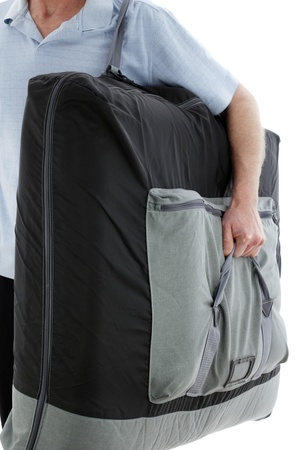 Professional licensed massage therapist man carrying a portable massage table on his way to do a outcall massage therapy for a client at his home.  photo
