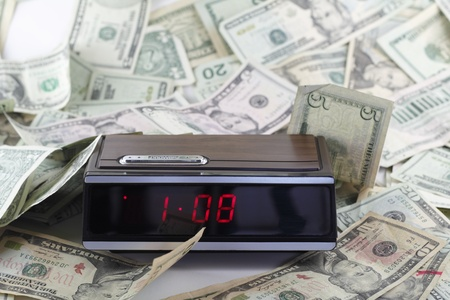 drowse: Old digital clock with a drowse button ticking time with American paper money of various denominations all around in random fashion.