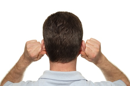 Caucasian man seen from the back self massaging both of his ears with his hands at the same time with reflexology in front of a white background.  photo