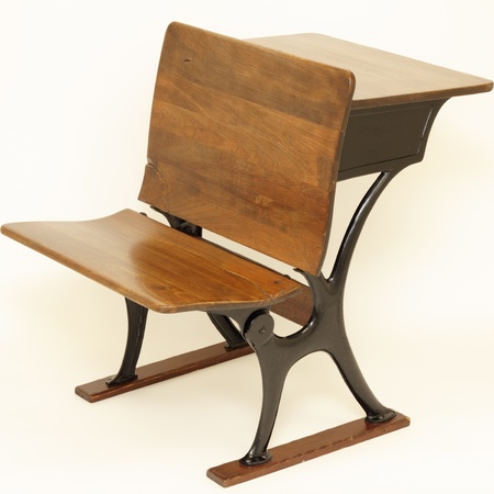 #14203282   Old Wood And Metal Combination School Chair In Front And School  Desk In Back.
