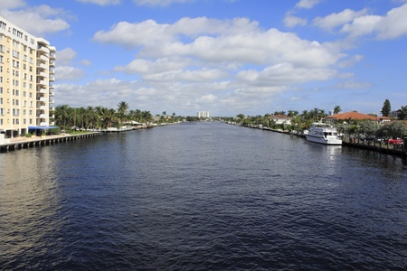 View of the Intracoastal waterway showing many boats and buildings north of Commercial Boulevard in Fort Lauderdale, Florida on a quiet Sunday morning autumn day  Banco de Imagens