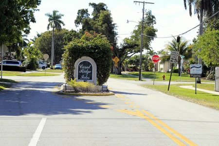 FORT LAUDERDALE, FLORIDA - OCTOBER 28, 2012: Coral Ridge Isles suburban neighborhood entry sign located on NE 15th Avenue south of Cypress Creek Road in Fort Lauderdale, Florida.