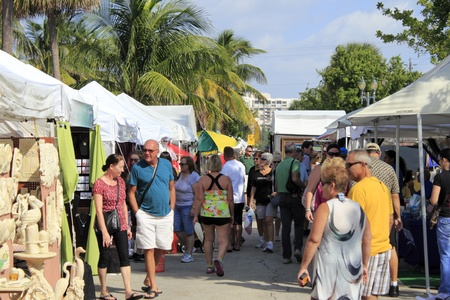 LAUDERDALE-BY-THE-SEA, FLORIDA - OCTOBER 28, 2012: People looking at the 14th annual craft festival where local artists display at outdoor galleries in Lauderdale-by-the-Sea, Florida.