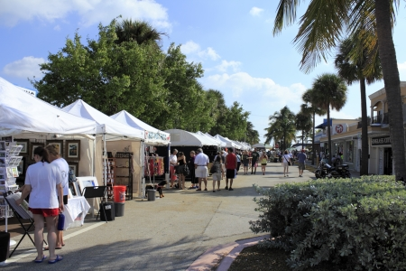 craft product: LAUDERDALE-BY-THE-SEA, FLORIDA - OCTOBER 28, 2012: People shopping early at the annual craft festival where local crafters display at outdoor galleries in Lauderdale-by-the-Sea, Florida.
