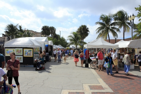 LAUDERDALE-BY-THE-SEA, FLORIDA - OCTOBER 28, 2012: Many people shopping at the outdoor annual craft festival where local artists display outside in Lauderdale-by-the-Sea, Florida.