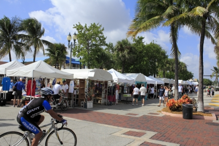 LAUDERDALE-BY-THE-SEA, FLORIDA - OCTOBER 28, 2012: Many people looking in many outdoor tents filled with local art at the 14th annual craft festival in Lauderdale-By-The-Sea, Florida.