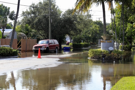hurricane sandy: FORT LAUDERDALE, FLORIDA - OCTOBER 28, 2012: Flooded streets in the Victoria Park neighborhood south of Sunrise a few days after Hurricane Sandy passed by in Fort Lauderdale, Florida.