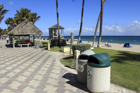 DEERFIELD BEACH, FLORIDA - FEBRUARY 1  Garbage and recycling cans, along with a recycling program that started in 1988, helps keep a busy beach clean on February 1, 2013 in Deerfield Beach, Florida
