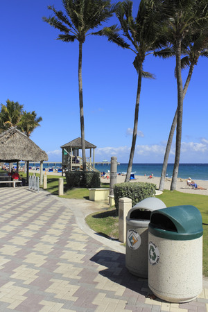 DEERFIELD BEACH, FLORIDA - FEBRUARY 1  Garbage and recycling cans, along with a comprehensive city recycling program helps keep a busy beach clean on February 1, 2013 in Deerfield Beach, Florida